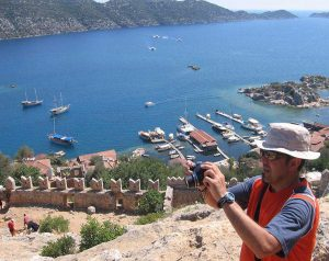 kekova island man taking photograph